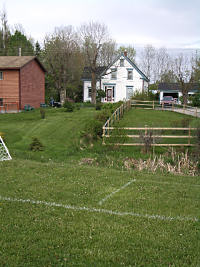 House bordering soccer field